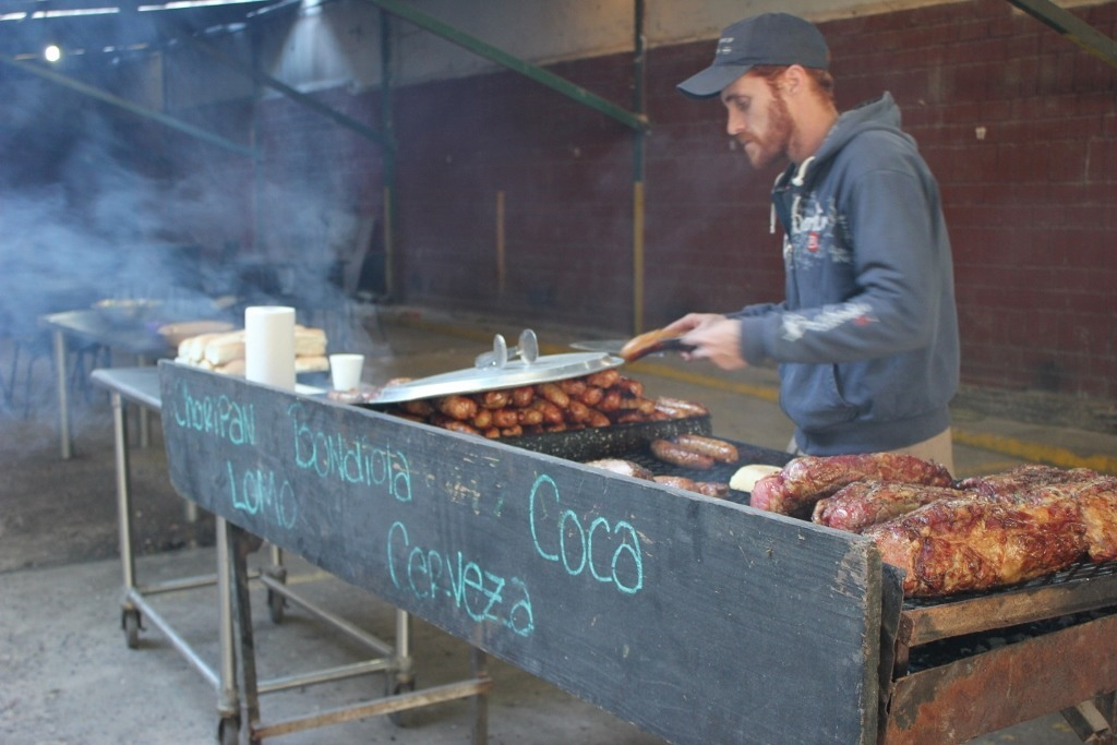 One-day itinerary for Buenos Aires: Stop for street food, like Choripans at the side-street, open-air Parrilla