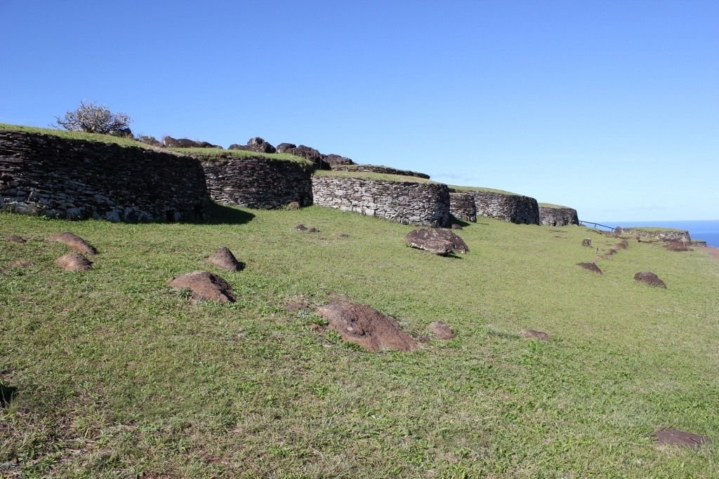Hike Easter Island: Historic dwellings on the side of the cliffs at Orongo