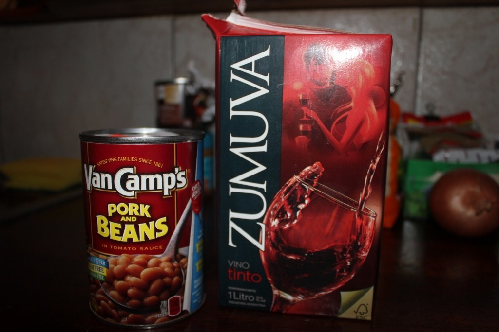 Can of Pork and Beans with carton of wine on Moorea, French Polynesia