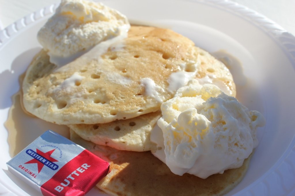 Staying at a beach resort: A rooftop, social Pancake breakfast with ice cream and syrup toppings