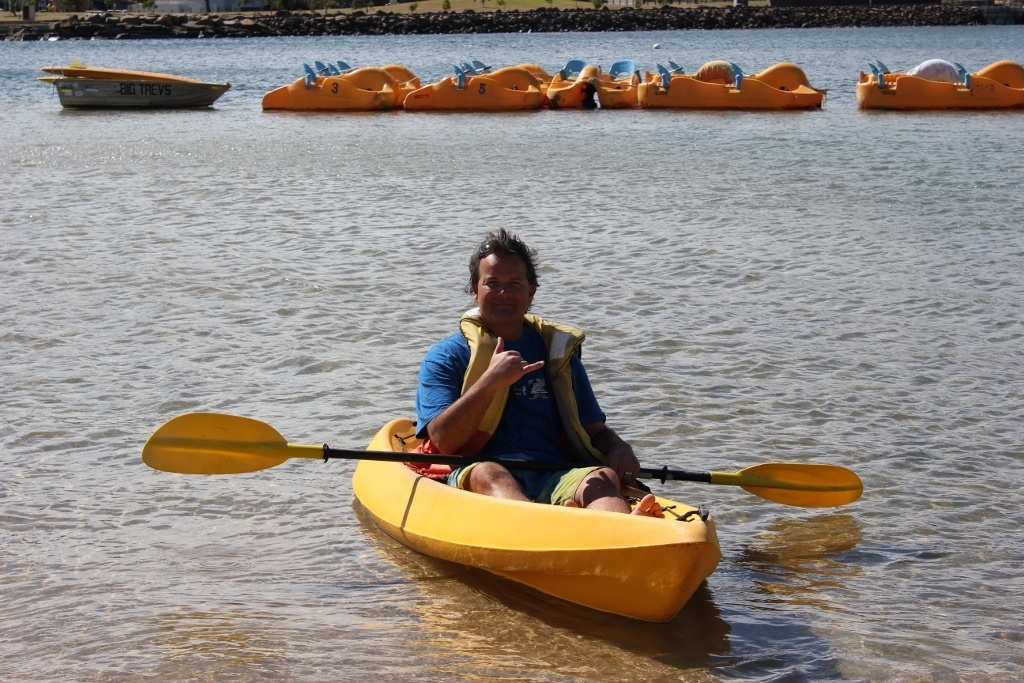 Staying at a beach resort: Kris using the kayak on Watersport day at the harbor