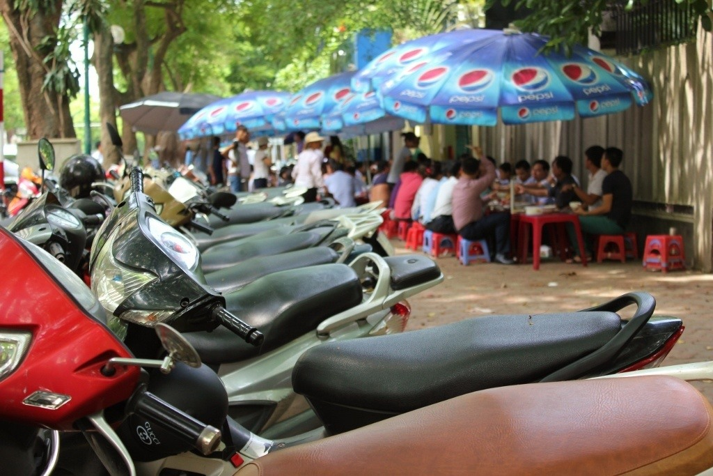 Streets of Hanoi: Where sidewalks are more likely to be used as parking lots and restaurants than for walking