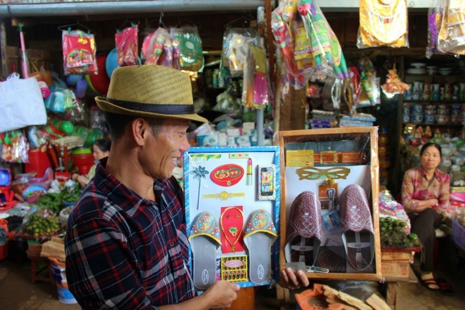 Secret Dalat Tour Guide, Mr. Rot, showing market products on Central Highland Vietnam Tour