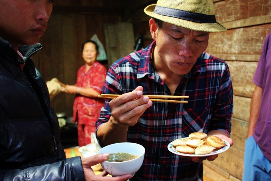 Touring Vietnam's Central Highlands: A moist rice cake with yolk dipped in a delicious sauce - so good!