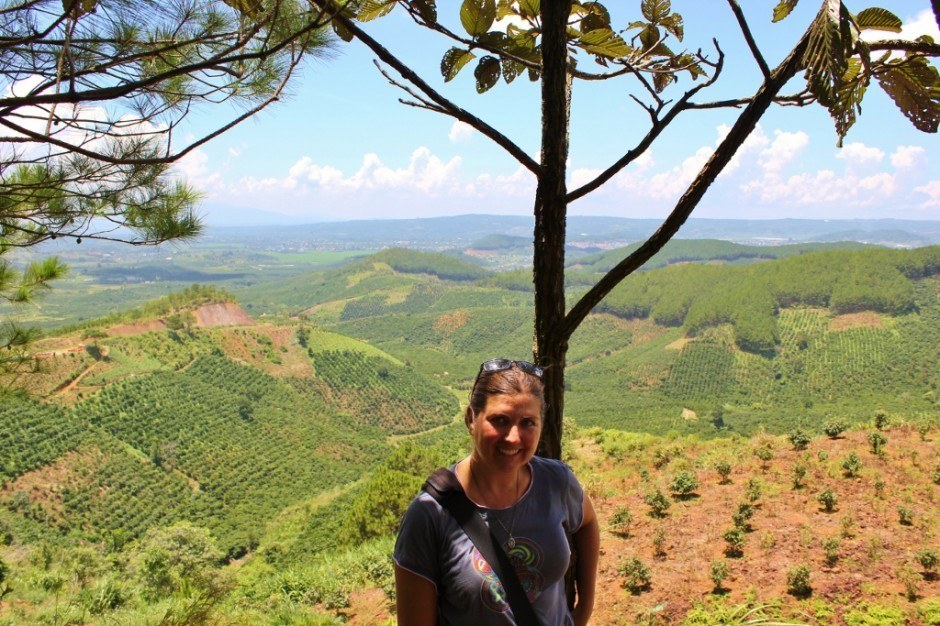 Sarah standing at lookout point over farms in Central Highlands Vietnam Dalat Tour