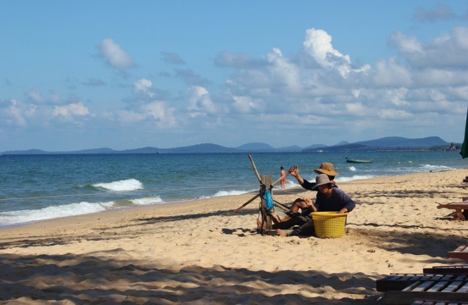 Phu Quoc Island, Vietnam: Fisherman reel in their line using pedals