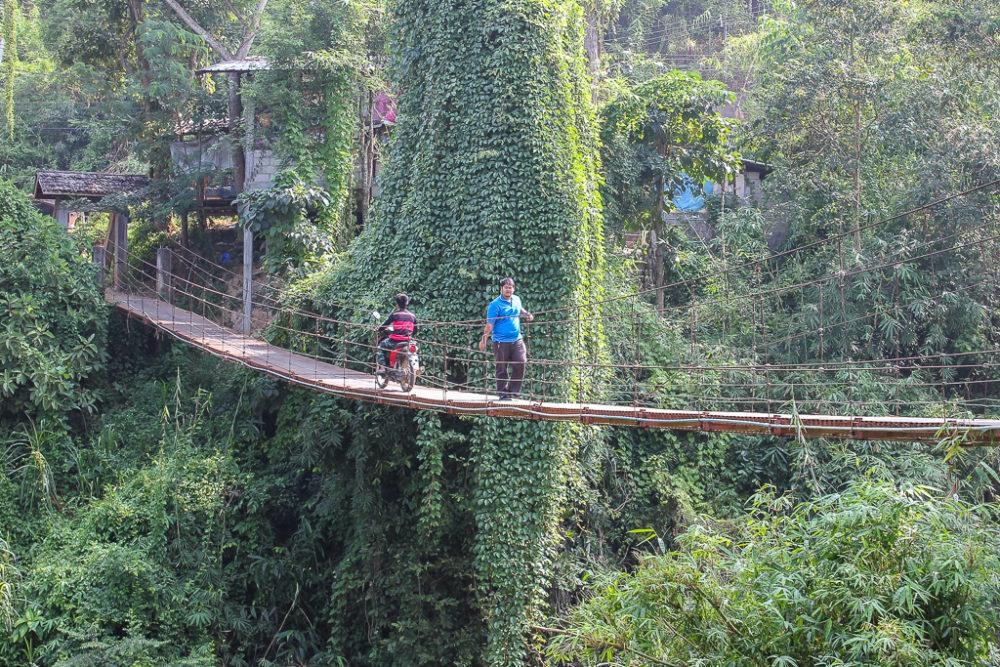 Crossing a swinging bridge in Chiang Mai, Thailand