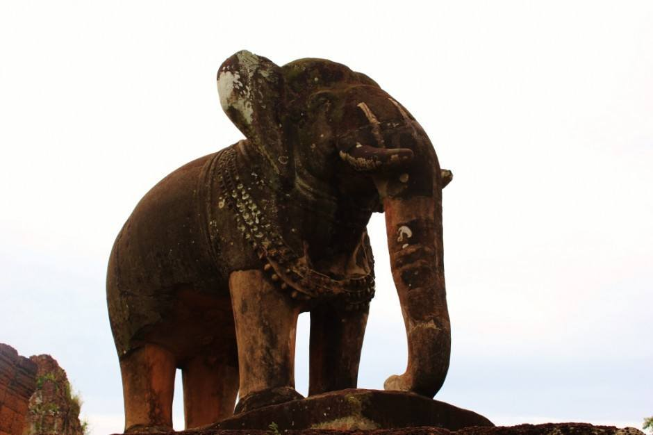Angkor Temple Tour: Eastern Mebon - elephant sculptures sit at the corners of Eastern Mebon