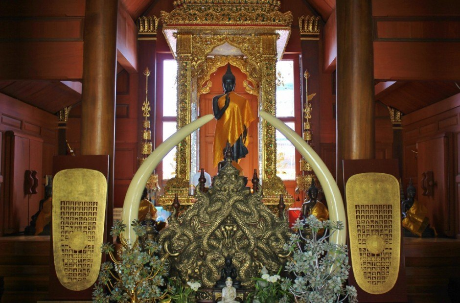 Visiting Chiang Mai temples: Doi Suthep Temple - elaborate altar with elephant tusks