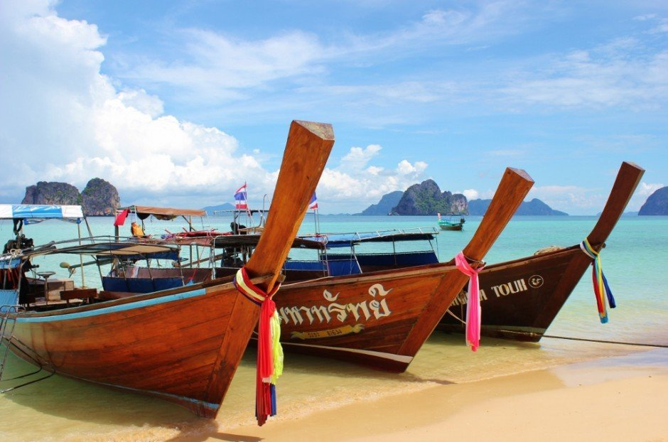 Long tail boats are used on the Four Island Tour from Koh Lanta, Thailand