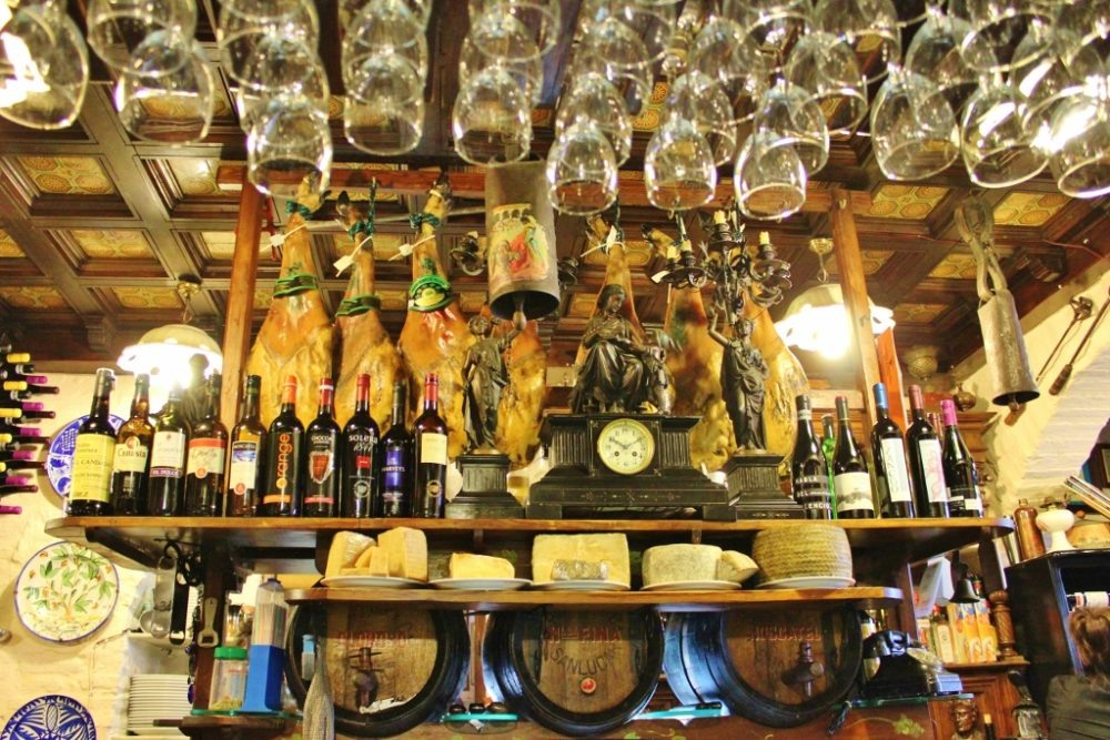 Displayed ham and cheese at Bodega Siglo XVIII tapas bar in Triana neighborhood in Seville, Spain