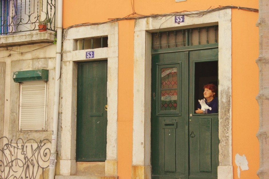 Residents perched in their windows is a common sight on the streets of Alfama.