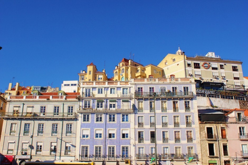 Bright colored buildings line the streets of Alfama.