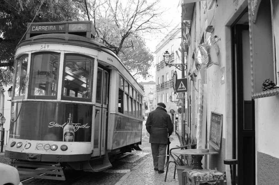 Trolleys ramble down the tracks on the streets of Alfama.