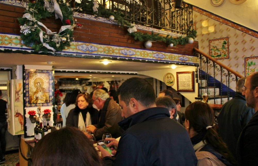Ordering the best tapas in Seville at Las Golondrinas tapas bar in Triana, Spain