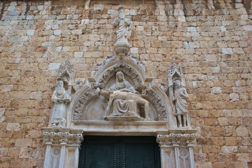 Decorative Pieta portal to Franciscan Church in Dubrovnik, Croatia