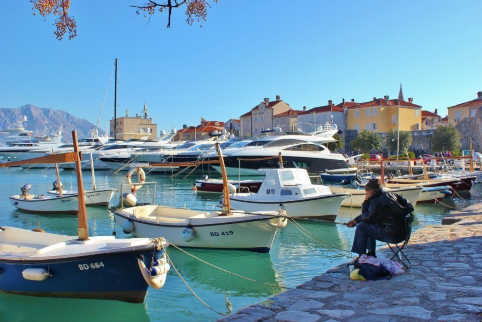 Budva, Montenegro Harbor and a lone fisherman