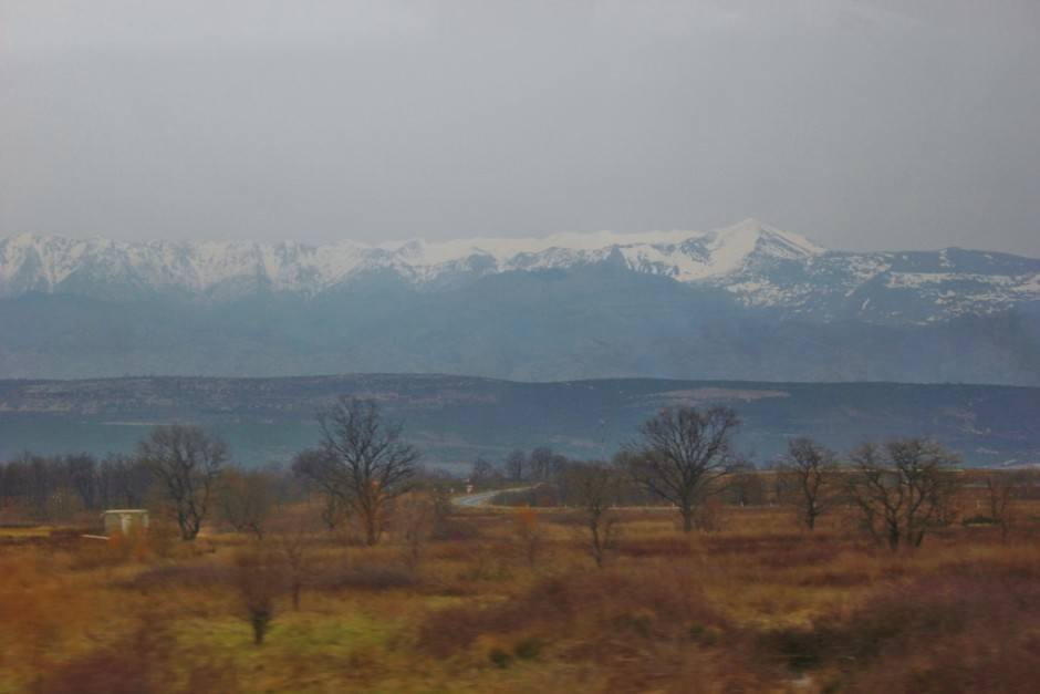 Arrival to Plitvice Lakes: Dreary skies were overhead as we got closer to the snow-capped mountains