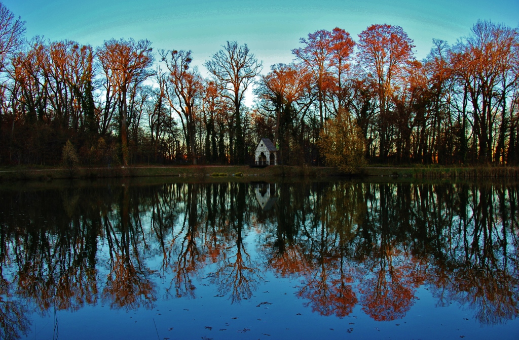 Autumn reflections on a lake at Maksimir Park in Zagreb, Croatia