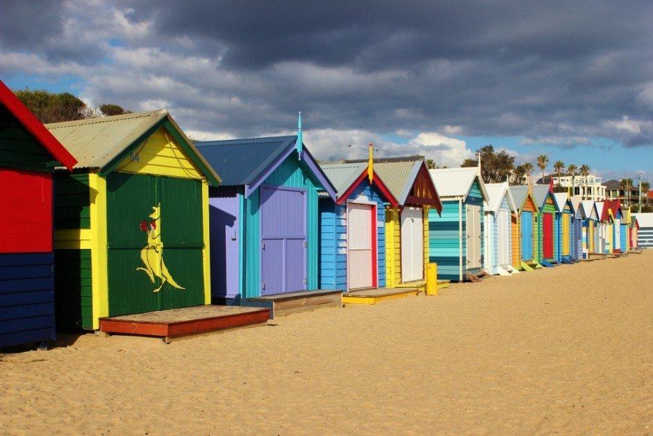 Brighton Beach Bathing Boxes look even brighter under a dark, cloudy sky
