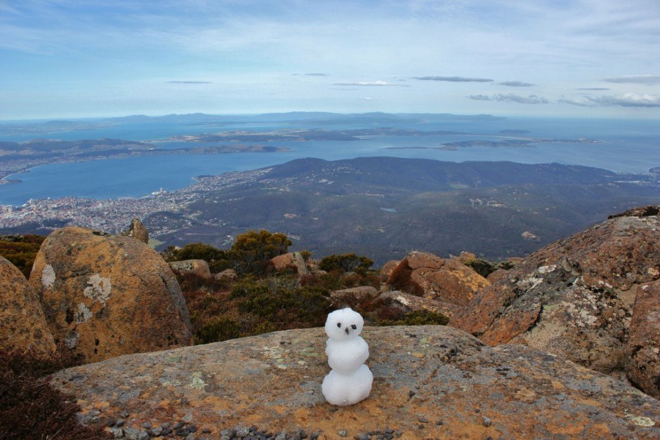 We made a small snowman before hiking down Mount Wellington