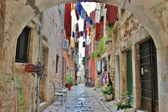 In Rovinj, Croatia, laundry hangs on lines that crisscross the narrow space between the pastel pink, yellow and stone buildings.