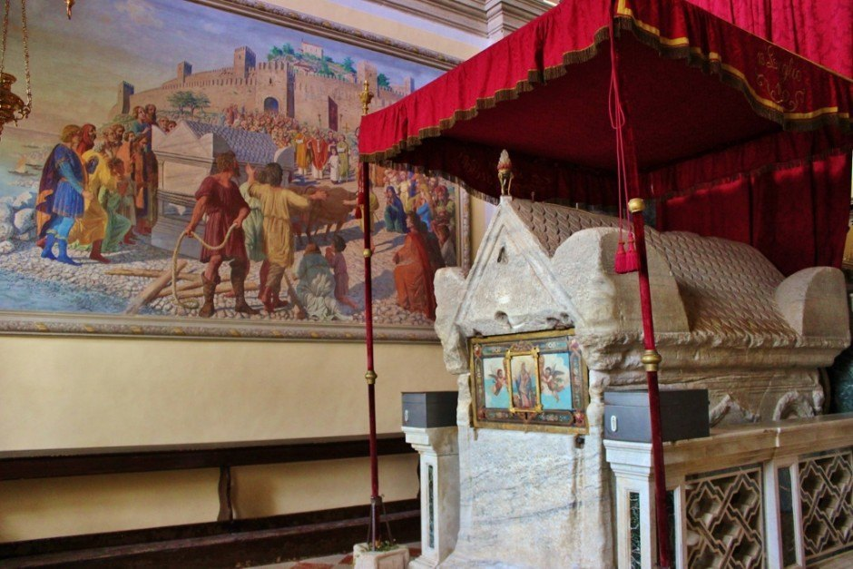 St. Euphemia's tomb and a painting depicting the story of how the tomb arrived in Rovinj, Croatia