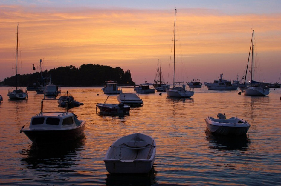 Watching sunsets in Rovinj, Croatia from the harbor added a special touch with bobbing baots in the foreground