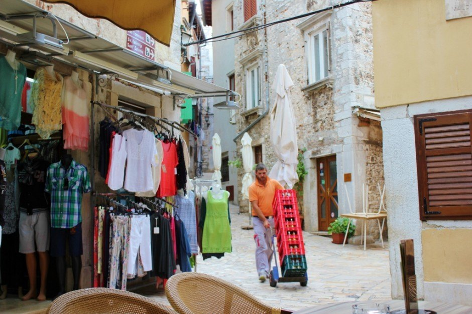 Deliveries aren't so easy in Rovinj, as it takes manual labor to bring bottled beverages to the cafes in the old town