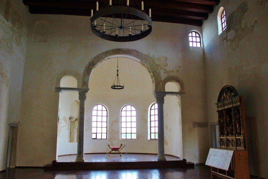 When we entered the Bishop's Palace (part of the Euphrasian Basilica in Porec, we noticed the solitary chair bathed in light and imagined walking in with the bishop sitting there