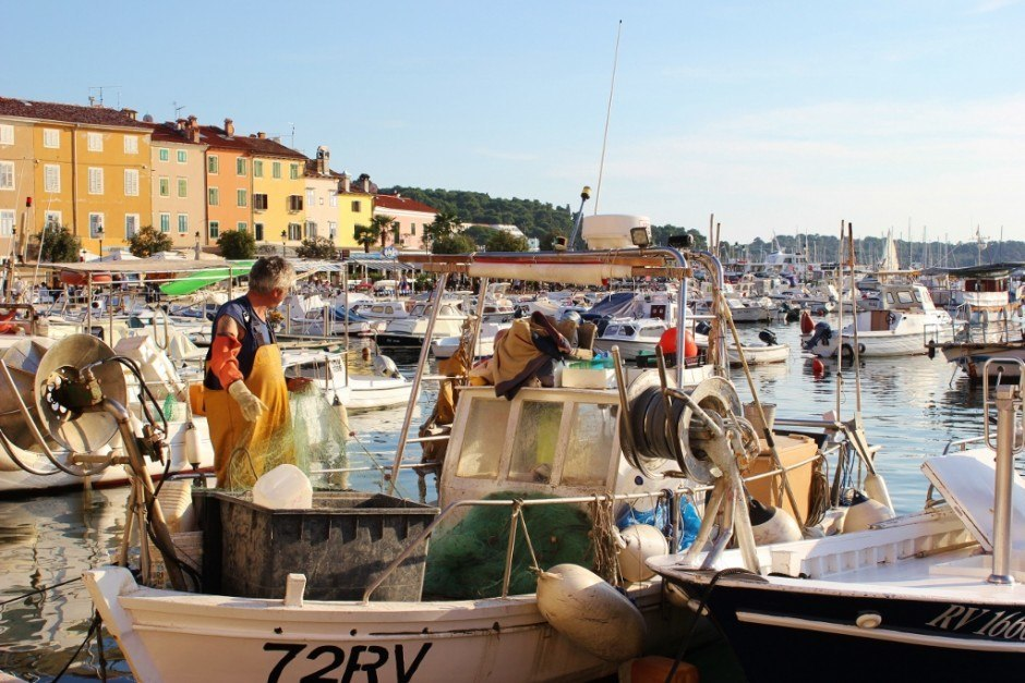 Fishermen working on nets is part of local life in Rovinj, Croatia