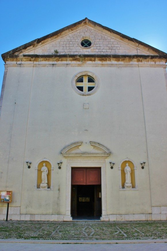 The plain facade of the Church of the Blessed Virgin Mary in Skradin, Croatia