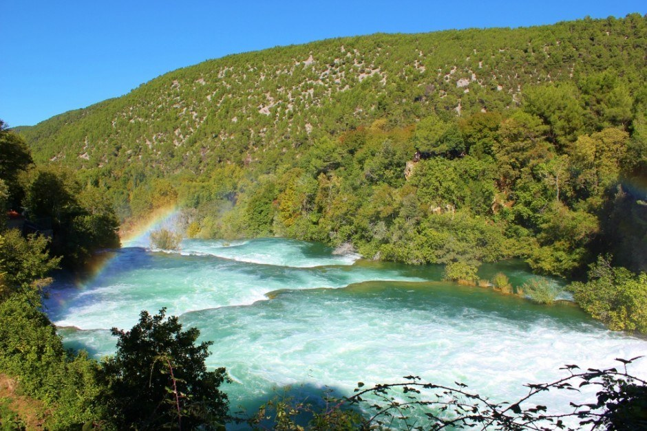 A rainbow rises in the mist on the Skradinski buk waterfall at Krka National Park