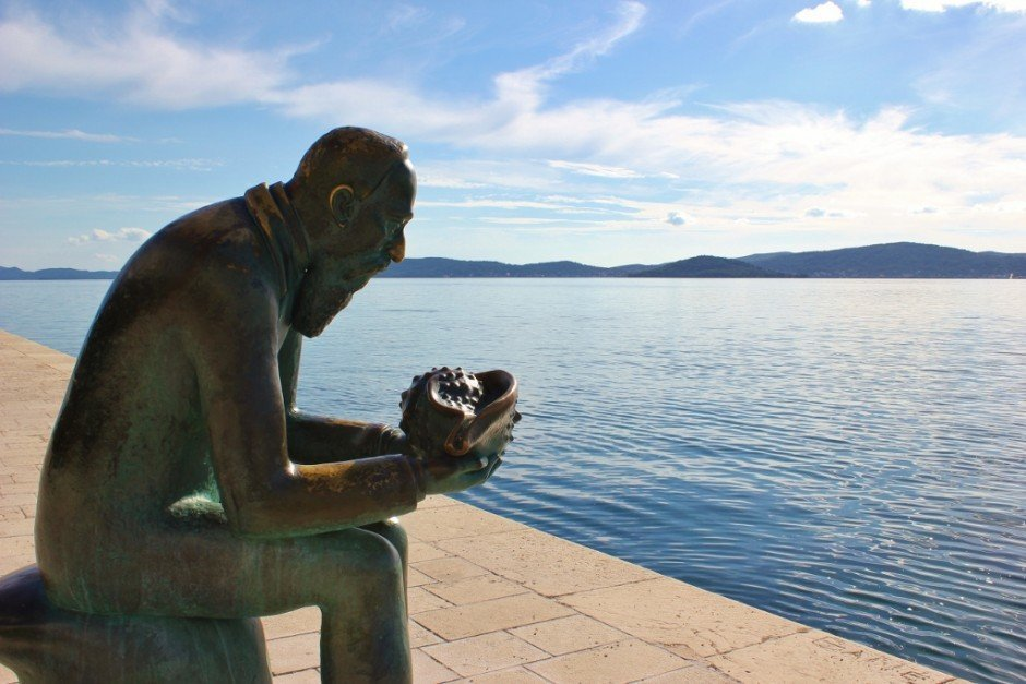 The Statue of Spiro Brusina, a Zadar intellectual, sits in front of the University of Zadar along the Riva