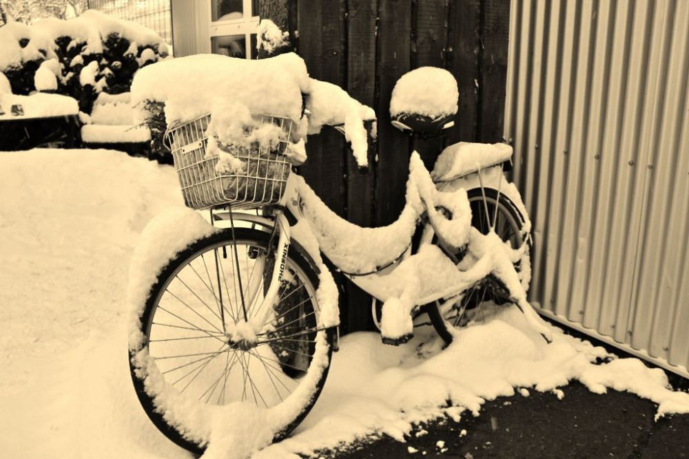 Iceland in Wintertime Snow covered bicycle JetSettingFools