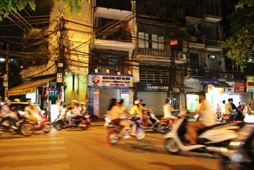 Watching scooter traffic in Hanoi is a great introduction to our 2-week Vietnam Itinerary