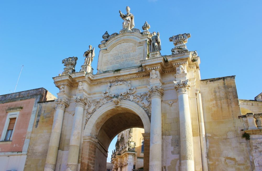Walk through the city gates in Lecce, Italy