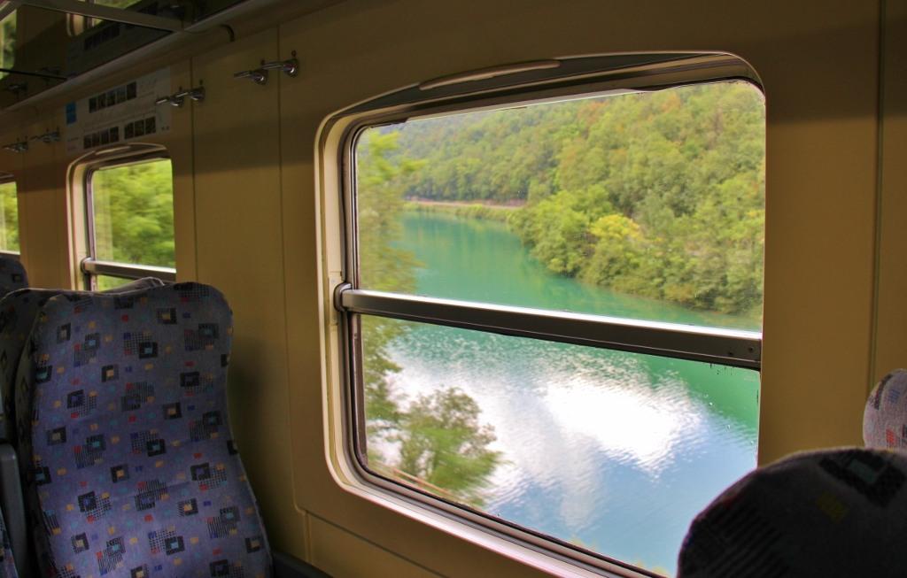 Train car seats with a view on Bohinj Railway the Scenic Train in Slovenia