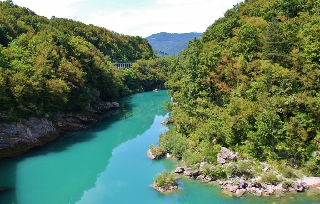 Pale Blue River, bridge and mountains on scenic train in Slovenia Bohinj Railway
