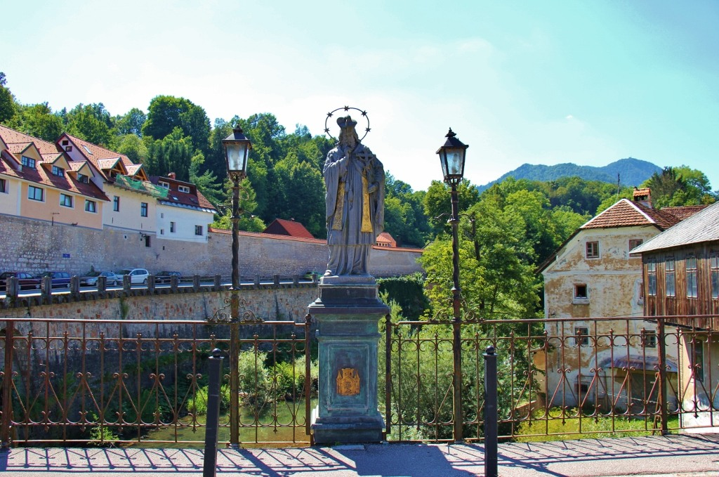 The Statue of St. John of Nepomuk on Capuchin Bridge is one of the sights in Skofja Loka