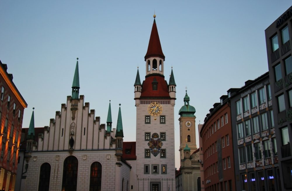 Sightseeing on a Layover in Munich Altes Rathaus Old Town Hall and the Talburg Gate at dusk JetSettingFools.com
