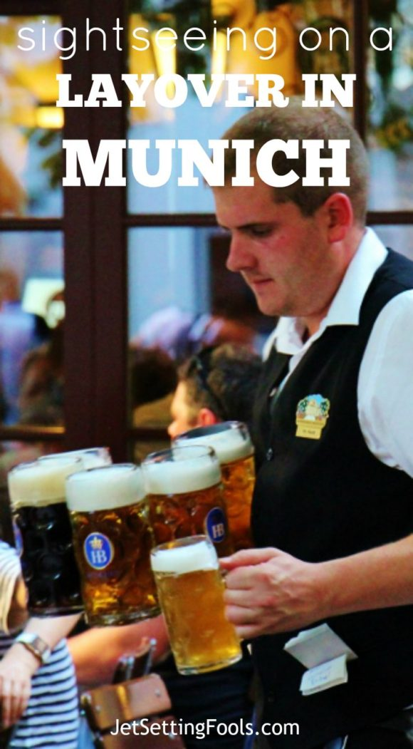 Sightseeing on a Layover in Munich Hofbrauhaus waiter carrying multiple steins JetSettingFools.com