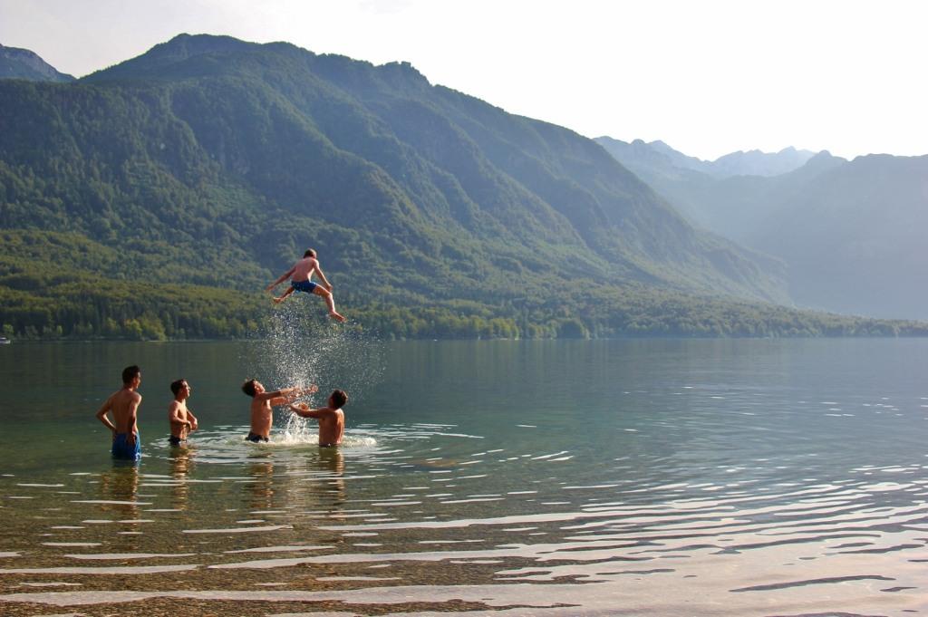 Kids Swimming In A Lake swimming lake bohinj, slovenia - jetsetting fools