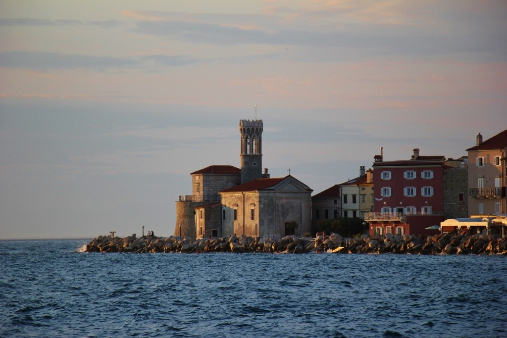 Church of Our Lady of Health and Lighthouse on point in Piran, Slovenia