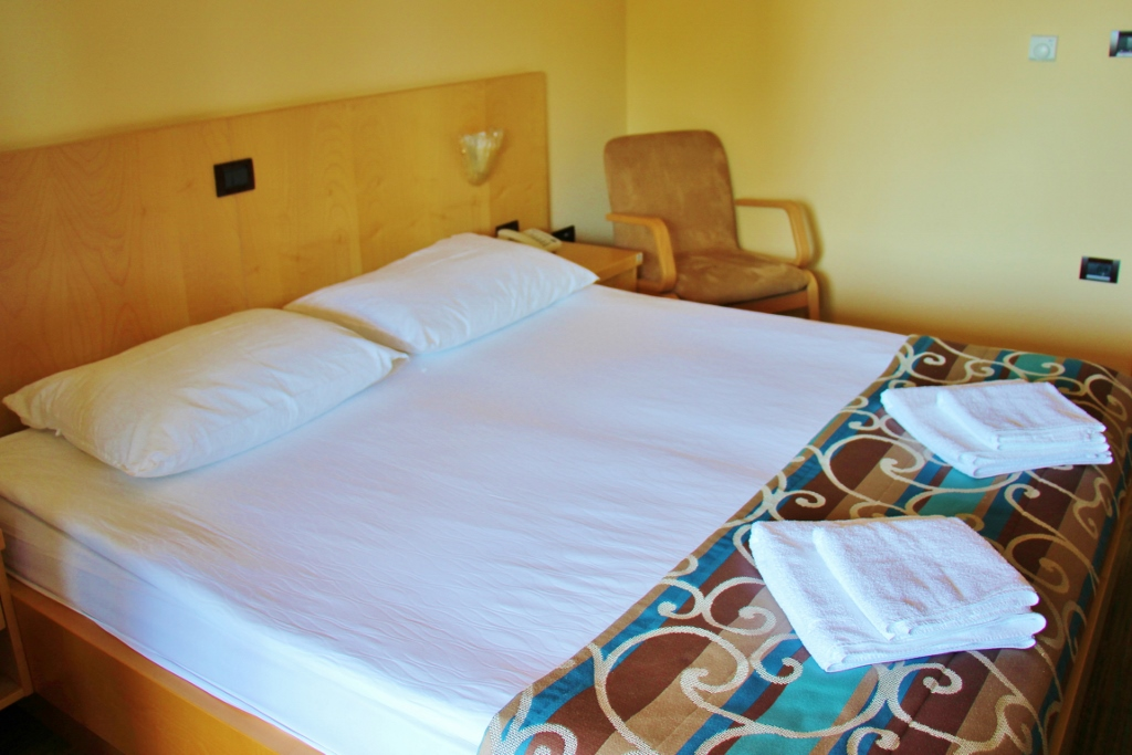 hotel-malovec-bedroom-bed-divaca-slovenia