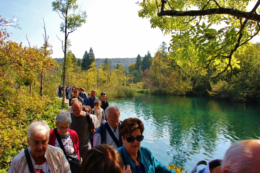 Crowds walk Upper Lakes Paths at Plitvice Lakes National Park, Croatia