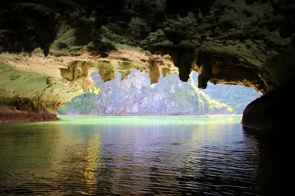 Kayaking through a cave on Halong Bay, Vietnam