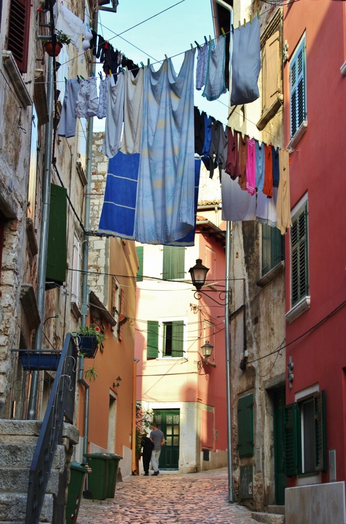 Laundry hangs between stone houses in Rovinj, Istria, Croatia