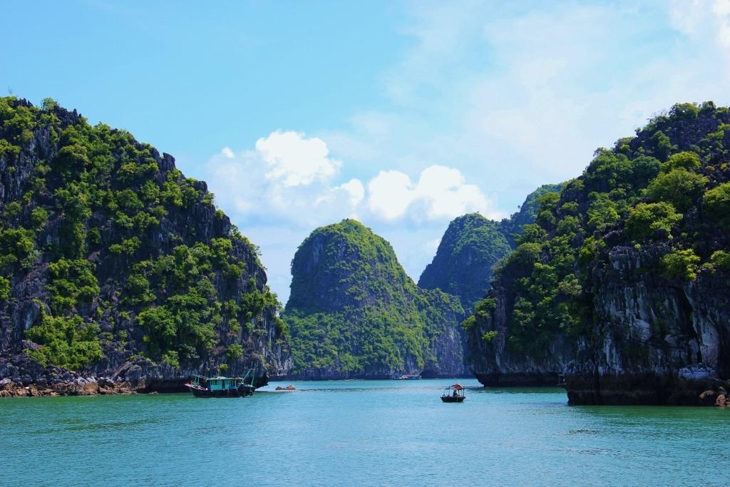Karsts and boat on Halong Bay Vietnam