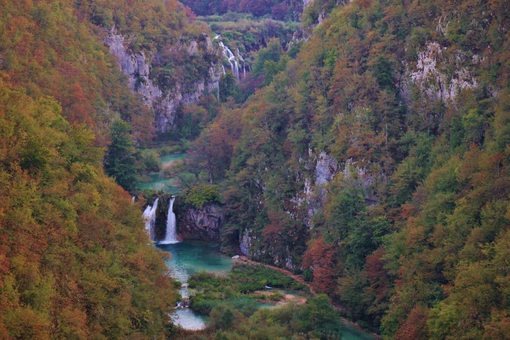 Waterfalls flow through canyon, Plitvice Lakes National Park, Croatia